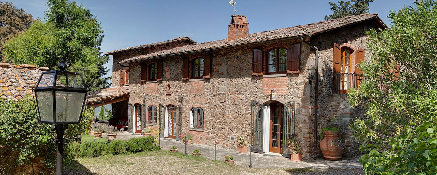 Typical Tuscan stone farmhouse overlooking the valley of Greve in Chianti