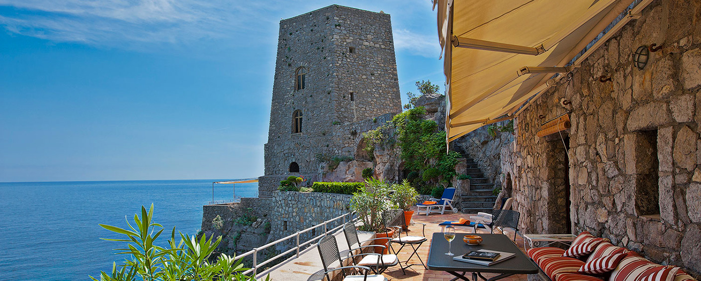 Unique accommodation in an ancient tower above the turquoise sea